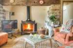 Farmhouse for holidays near Aberdaron - lounge with wood burning stove