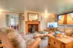 North Pembrokeshire, Abercastle holiday home - sitting room with wood burning stove