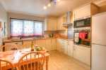 Self-catering cottage near New Quay - modest kitchen/diner with glimpses of the sea