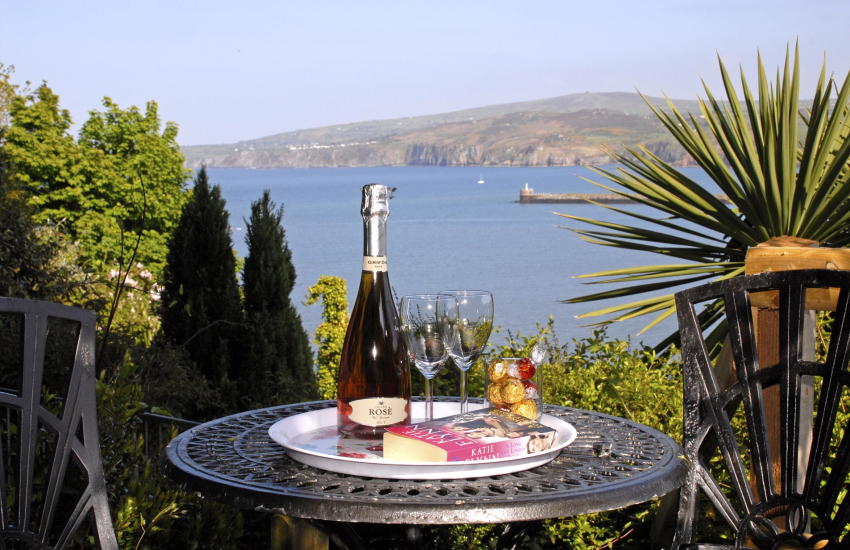 Secluded patio with sea views at top of the gardens