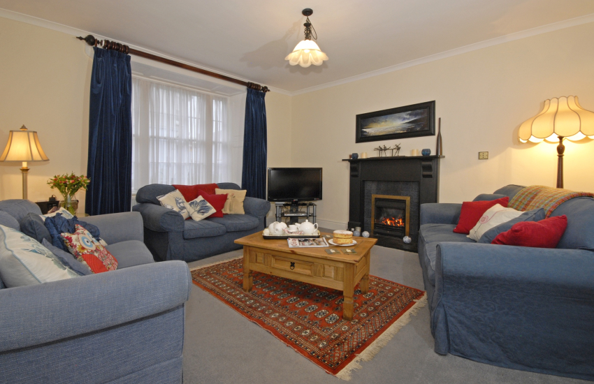 St Davids city family holiday home - cosy lounge with open gas fire - pets welcome