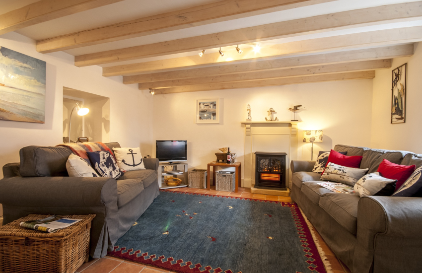 St Davids cosy holiday cottage - sitting room with electric effect stove