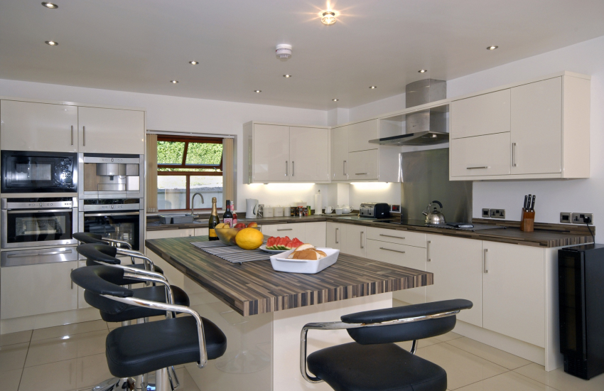 Luxury open plan kitchen diner with Neff integrated appliances