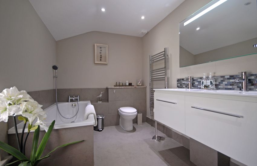Family bathroom with separate walk in shower