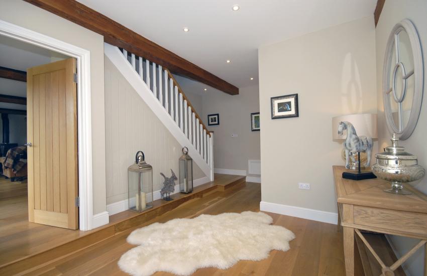 Hallway with oak floors
