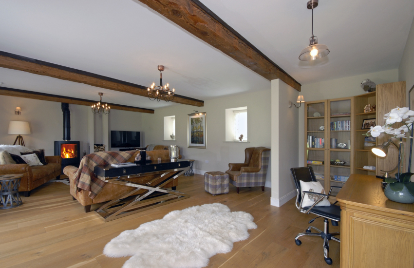 Pembrokeshire luxury holiday home - Cosy living room with wood burning stove
