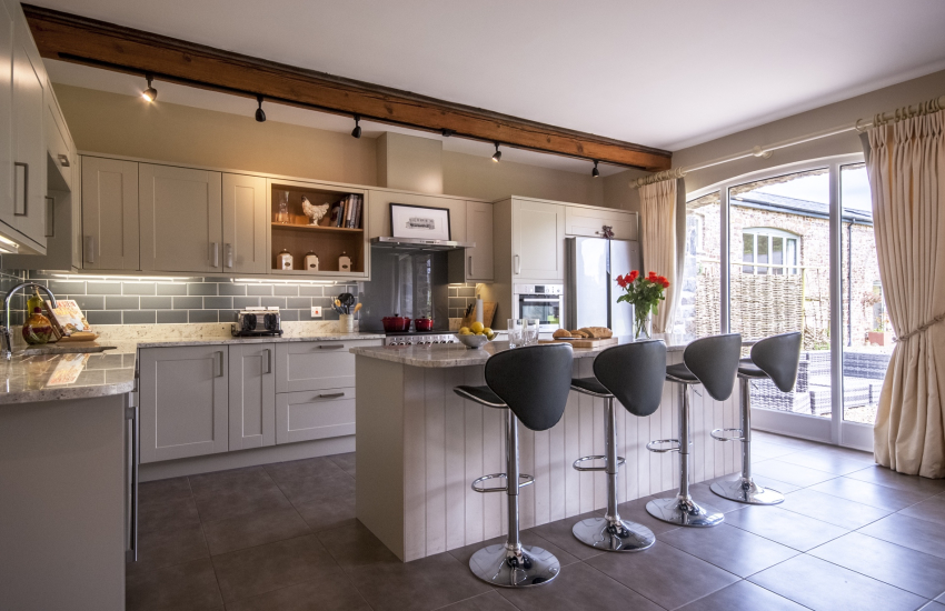 Spacious modern kitchen with breakfast bar