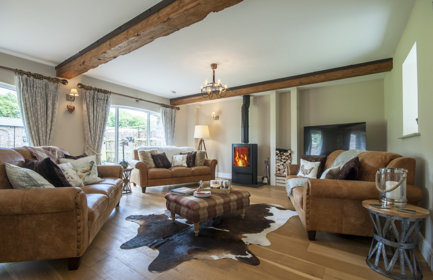 Pembrokeshire luxury holiday home - living room with log burning stove