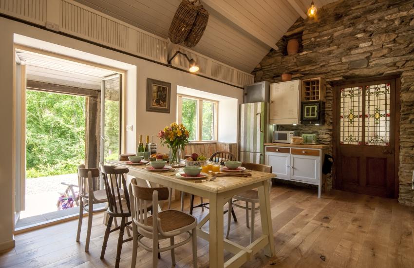 Open plan kitchen/dining area with garden views