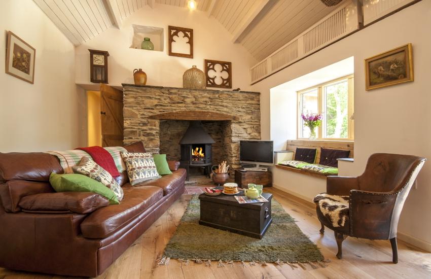 Abermawr holiday cottage sitting room with inglenook and Jotul log burning stove