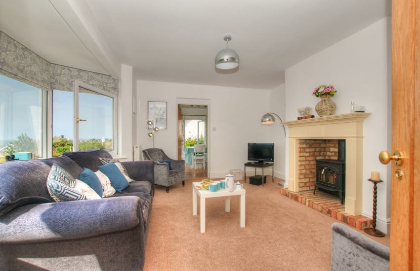Welsh cottage by the sea - lounge with gas fire
