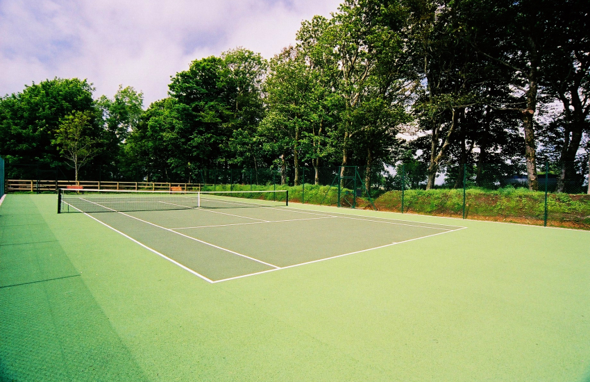 Tennis court is available at this Farmhouse holiday cottage