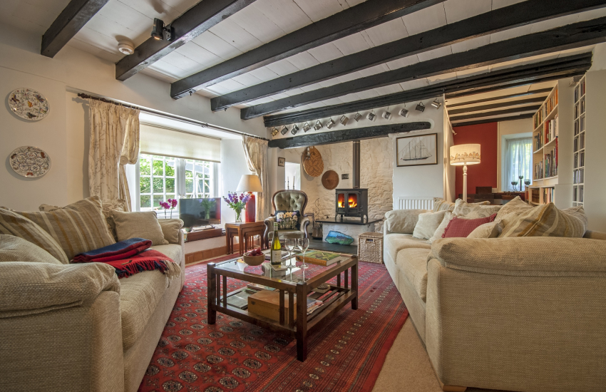 Cosy living room with large inglenook and wood burning stove