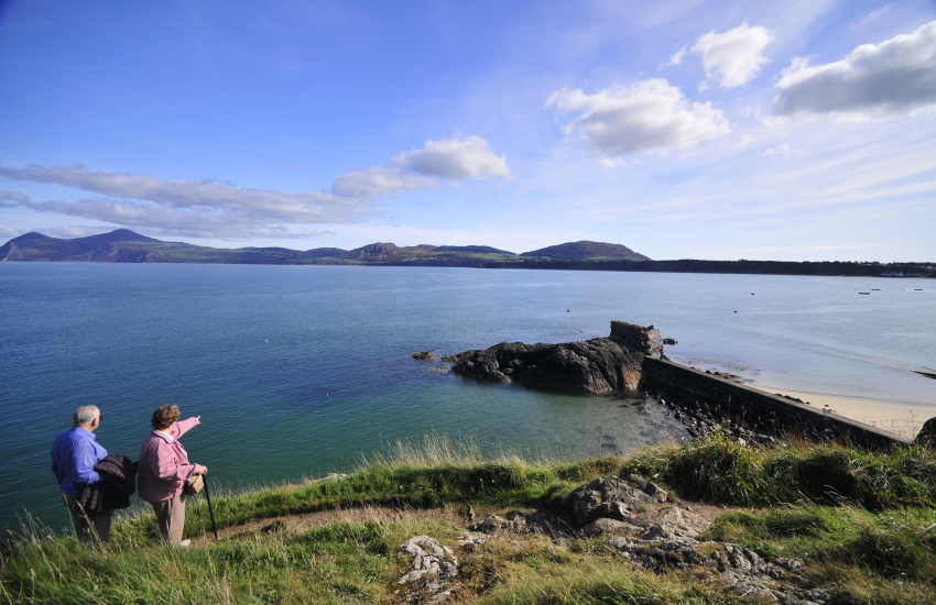 Walkers on the headland at Porthdinllaen enjoying spectacular views