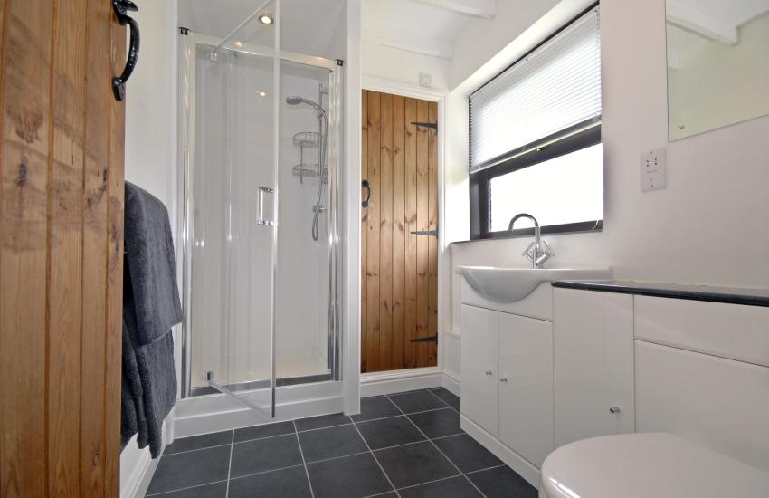 Ground floor shower room adjacent to double bedroom