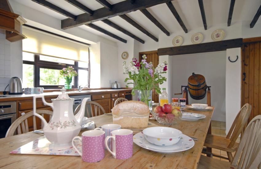 An original butter churn stands in the kitchen