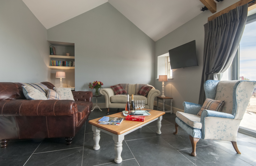 St Davids holiday cottage - sitting room with Bi-fold doors to the patio