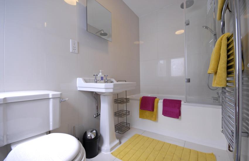 Second floor master double en suite bathroom with shower over