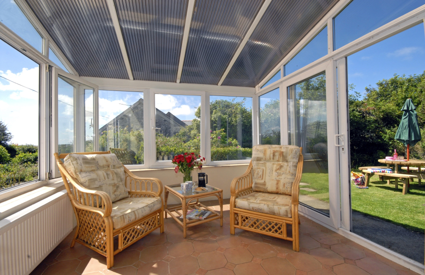 Conservatory with patio doors to the gardens