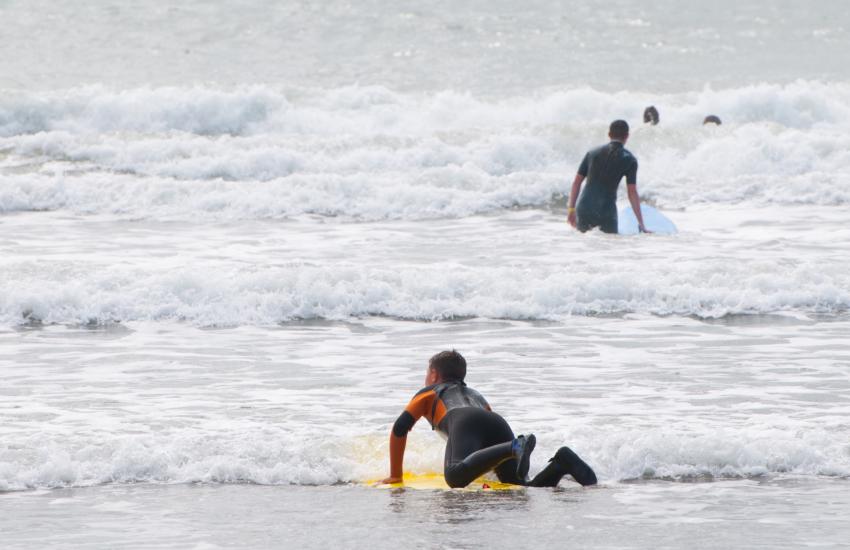 surfers and beach fun