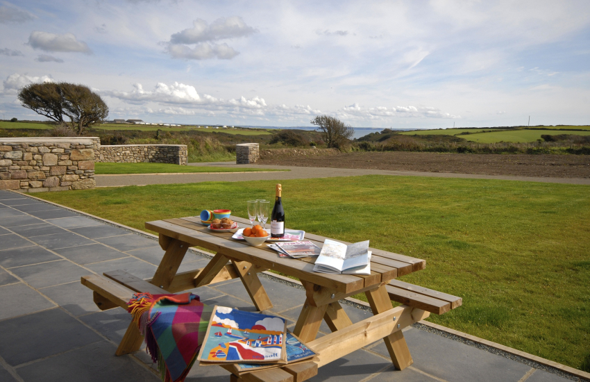 Enjoy sweeping views over the coast from the patio at Porthclais View