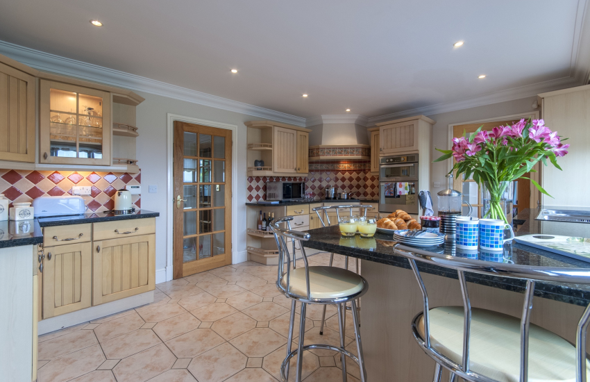 Spacious fitted kitchen with breakfast bar