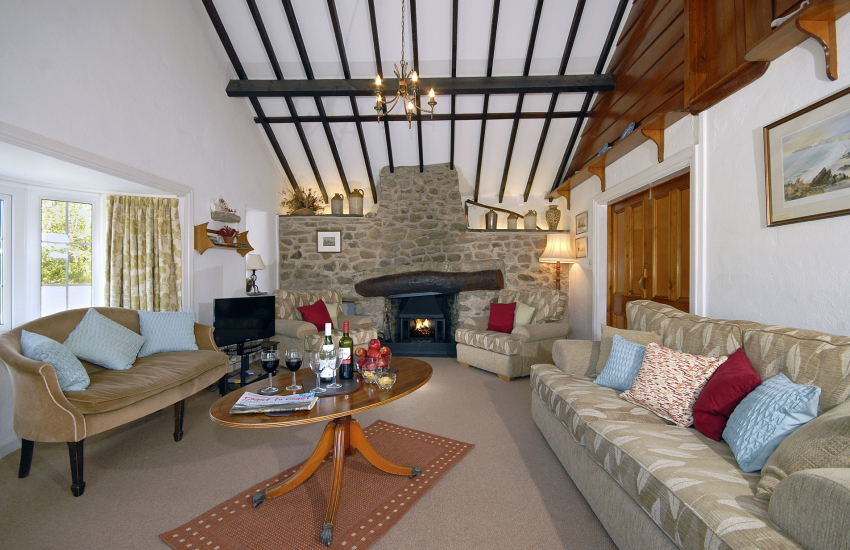 St Davids traditional holiday cottage sitting room with log burning stove - pets welcome