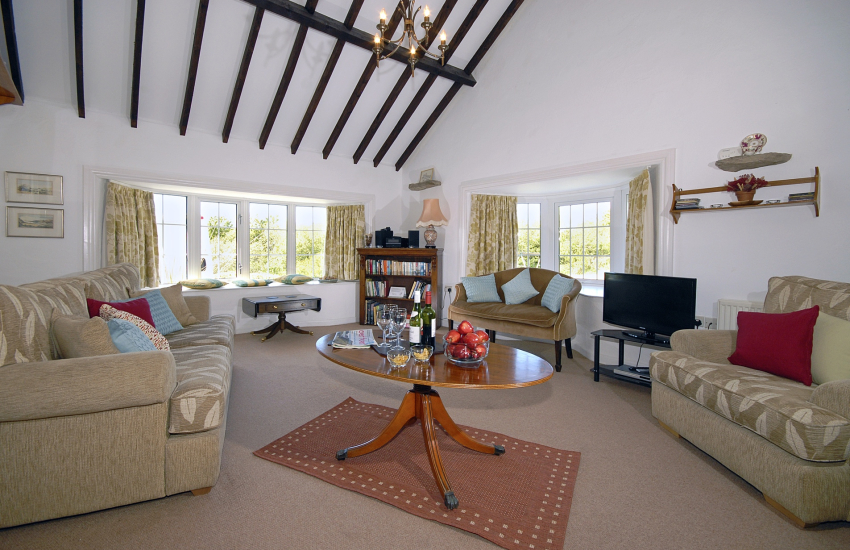 Solva traditional holiday cottage sitting room with countryside views - dogs welcome