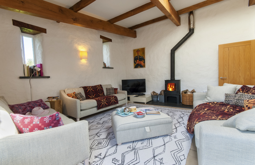 North Pembrokeshire barn conversion - sitting room with wood burning stove