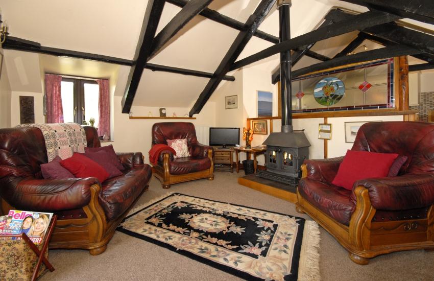 Cardigan Bay Heritage Coast holiday cottage - lounge with wood-burning stove