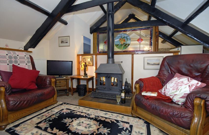 Cardigan Bay Heritage Coast holiday cottage - first floor lounge with log-burning stove