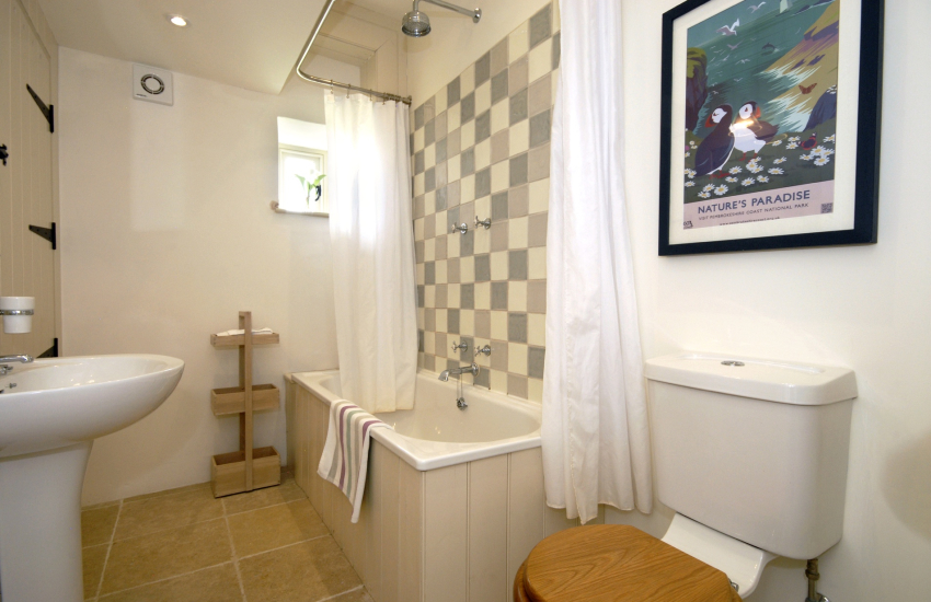Ground floor family bathroom with shower over bath