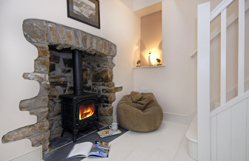 Cosy cottage with log burning stove in the hallway
