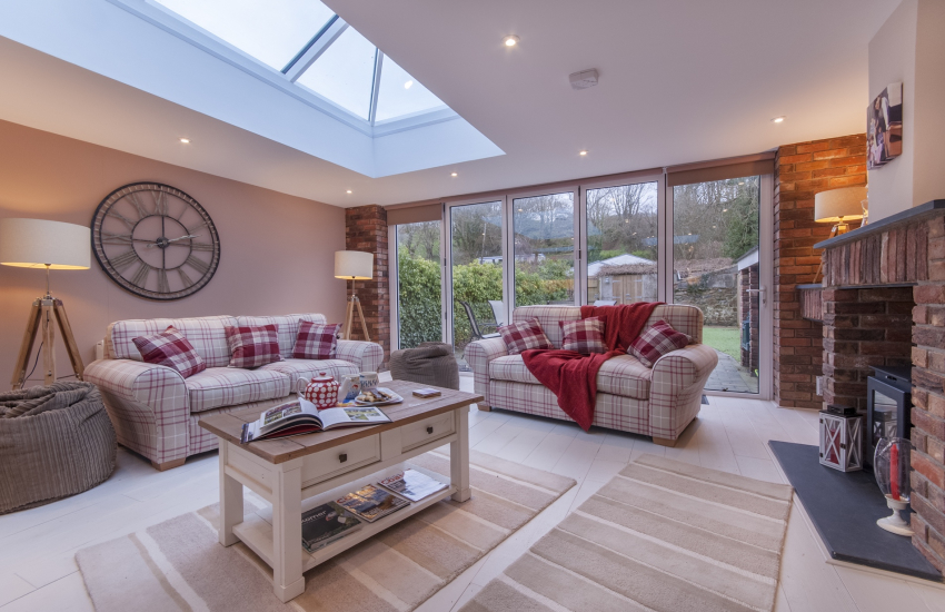 Luxury open plan living room with Bi-fold doors to the garden