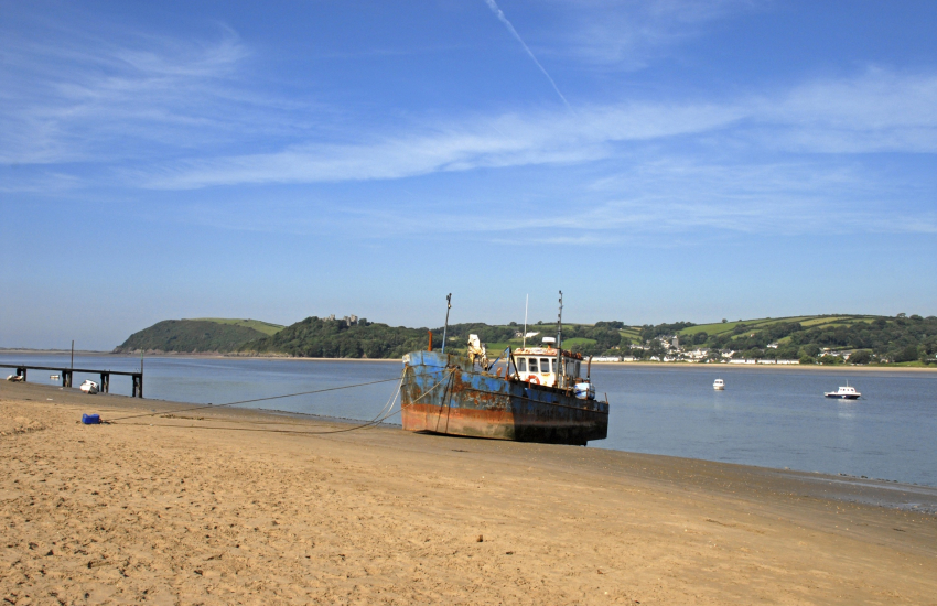 Ferryside's sandy beach is on the east bank of the Towy Estuary
