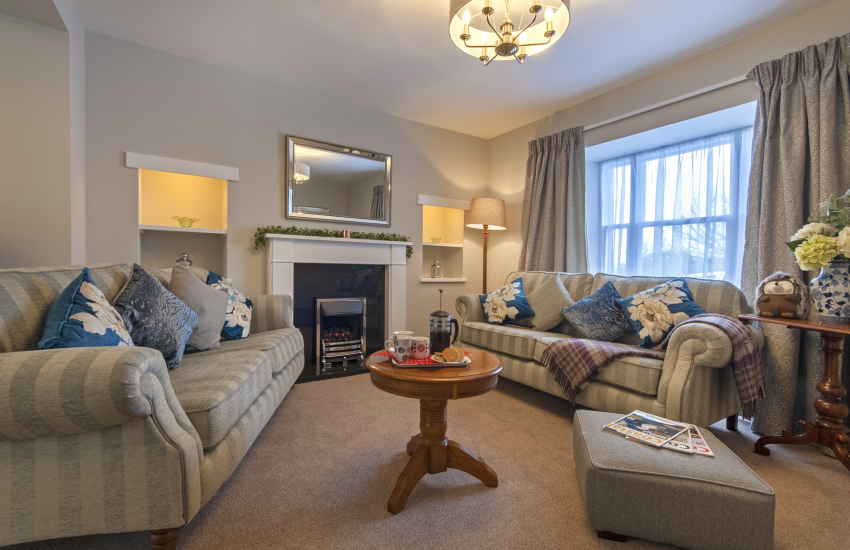 St Davids city family holiday home - large sitting room with open gas fire