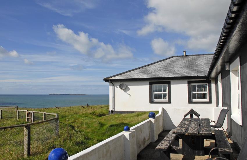 Dale coastal holiday home - patio with coastal views