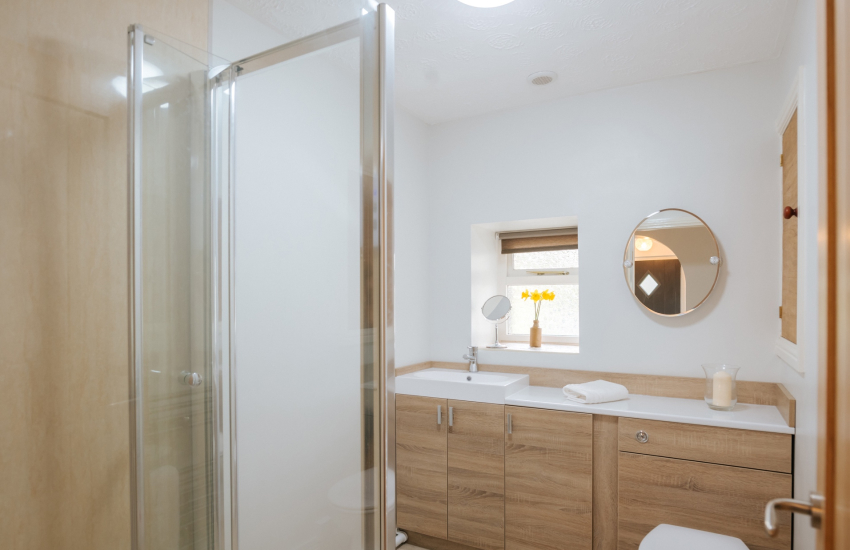 Shower cubicle, toilet and wash hand basin