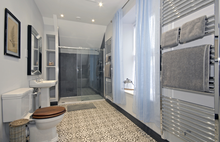Family bathroom with double walk in shower and free standing bath
