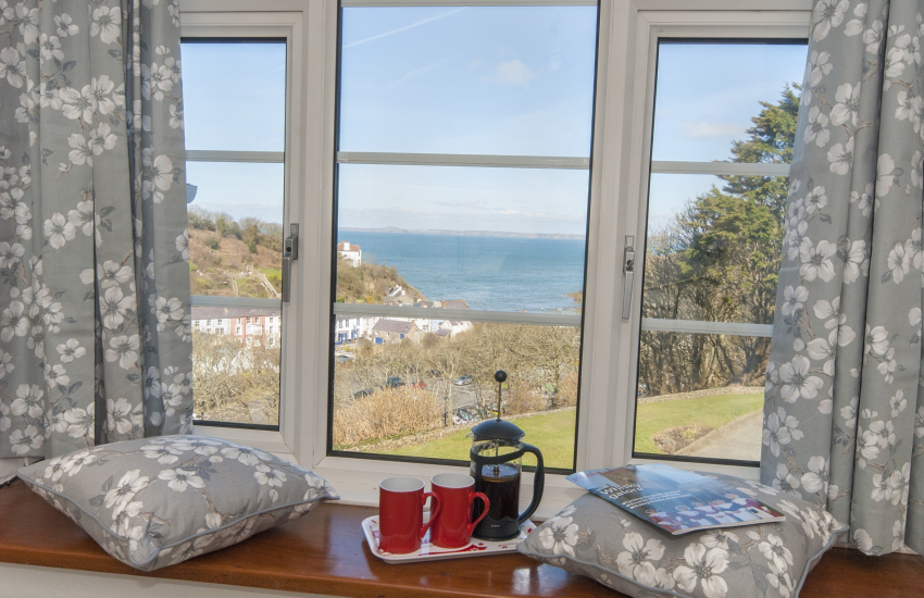 King size bedroom with views over Little Haven