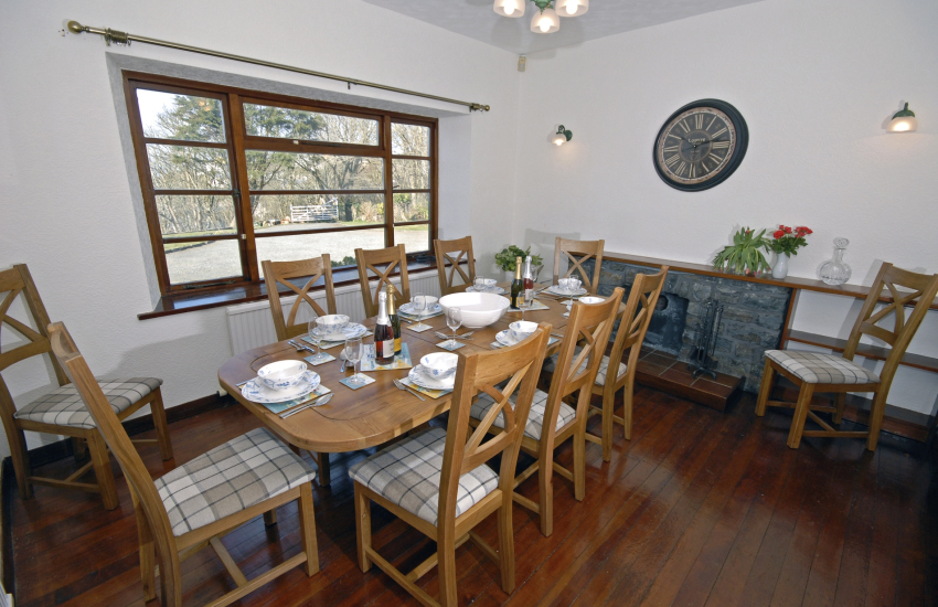 North Pembrokeshire holiday home - dining room with sea and garden views