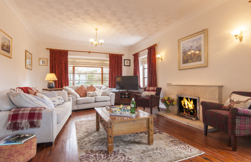 Little Haven family holiday home - sitting room with open fire