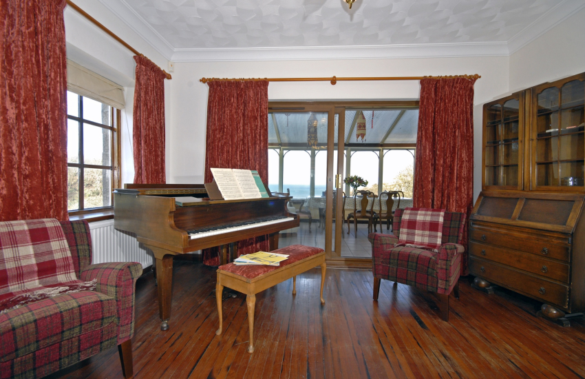 Baby grand piano at Seaside House, Little Haven