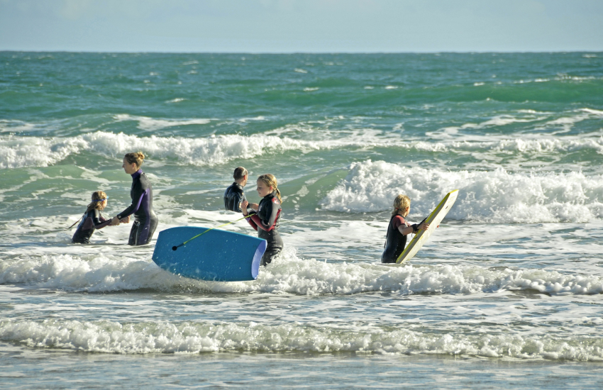 Surfing and bodyboarding in the crystal clear waters of Marloes Sands