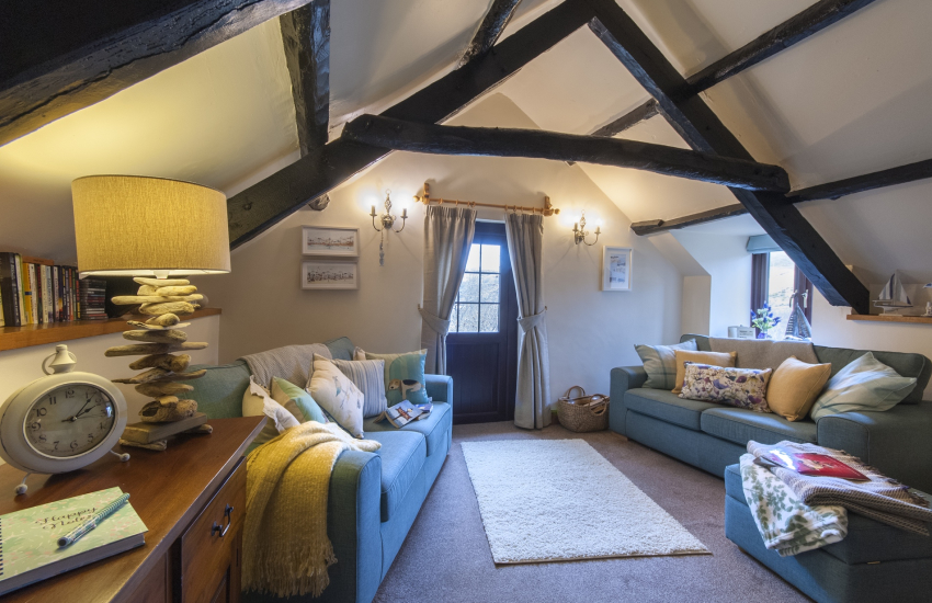 Pet friendly Cwm Tydu cottage - lounge with log burner