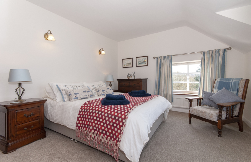 King size bedroom with seaside views