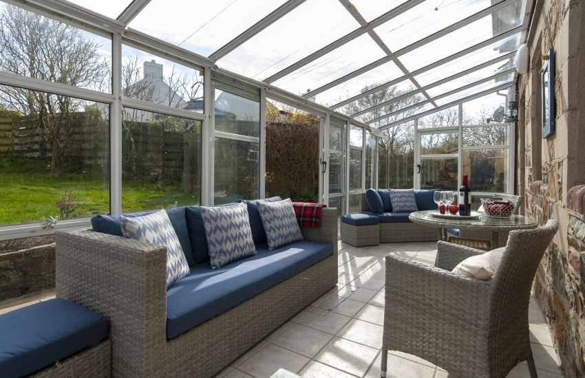 Conservatory overlooking the enclosed rear gardens