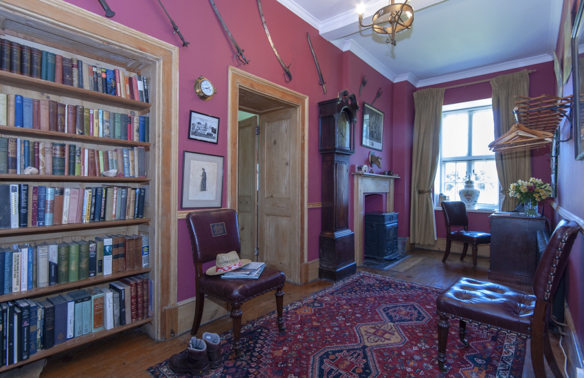 Gwaun Valley holiday manor house with study desk and log burning stove in the hall