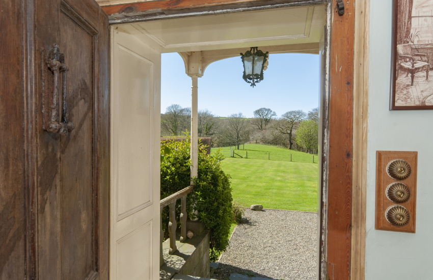 Views over the lawns to the Gwaun Valley woods beyond from the front entrance