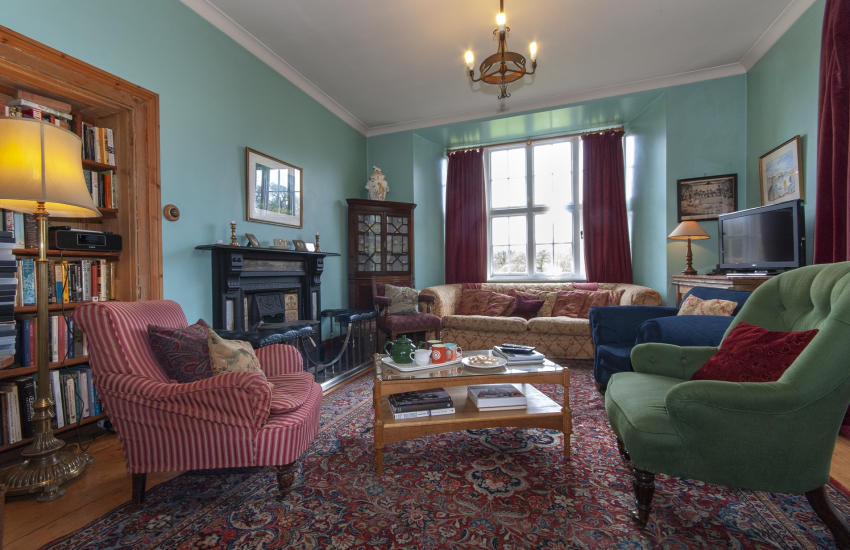 Gwaun Valley, Pembrokeshire large Manor House for family holidays - sitting room with log burning stove